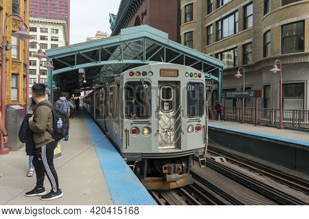 Chicago, Illinois - April 23,2018 : The View Of Elevated Train Approaching Station In Chicago,usa On