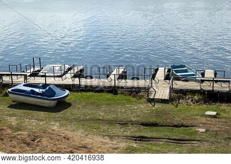 Pier For Rental Water Equipment-catamarans Boats People Recreation Water Entertainment