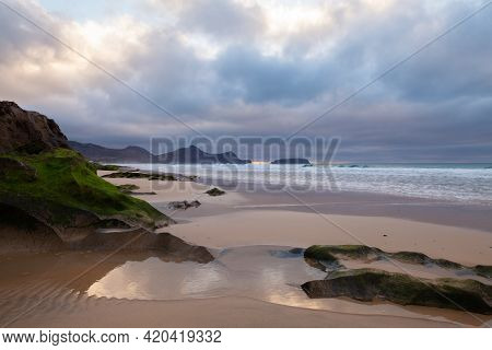 Landscape With Wet Coastal Rocks. Beach Of Porto Santo, Island In The Madeira Archipelago, Portugal