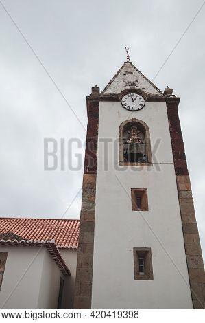 Bell Tower Of The Paroquias Do Porto Santo Under Cloudy Sky. Porto Santo Island, Portugal