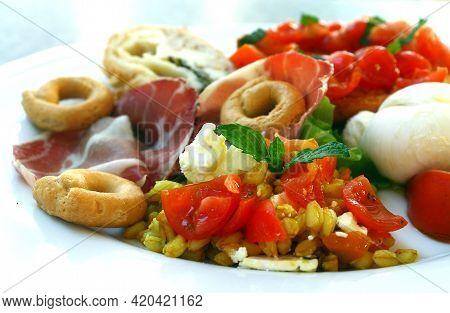 South Italy Delicatessen With Mozzarella Cheese, Tomato Bruschetta, Cold Cuts