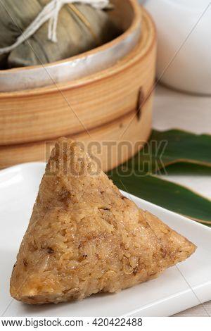 Zongzi. Rice Dumpling For Dragon Boat Festival On Bright Wooden Table Background.