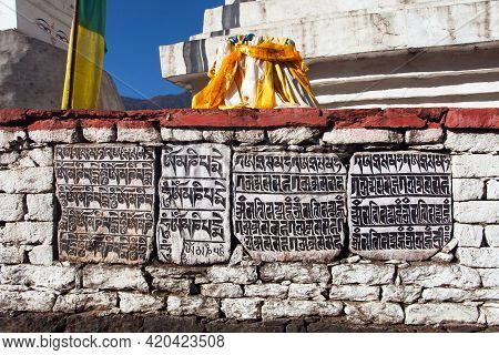 Buddhist Mani Prayer Wall On The Way To Everest Base Camp With Buddhist Tibetan Symbols And Prayer F