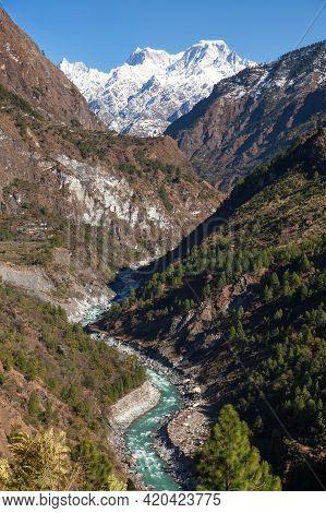 Himalaya, Panoramic View Of Indian Himalayas, Great Himalayan Range And River Valley With Wood, Utta