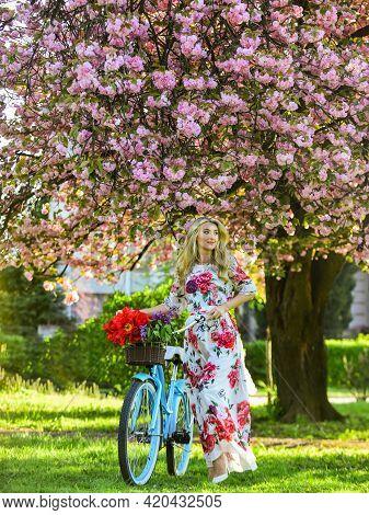Sakura Season. Romantic Bike Ride. Tourism Concept. Transportation And Travel. Girl Long Dress Retro