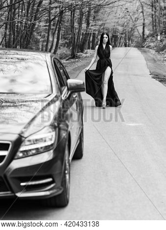Rich People Lifestyle. Start Journey. Luxury Car. Auto And Pretty Sexy Woman At Road. Travel Concept
