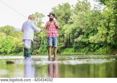Fishing Skills. Fish With Companion Who Help In Emergency. Bearded Man Elegant Businessman Fish Toge