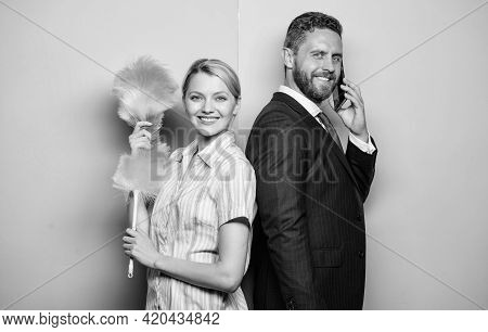 Family Couple. Housewife And Businessman. Career And Housekeeping. Wife Stand With Dust Brush Husban