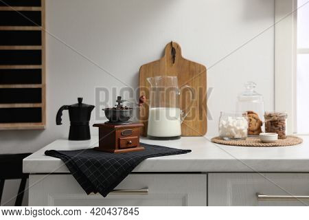 Vintage Manual Coffee Grinder On Counter In Kitchen