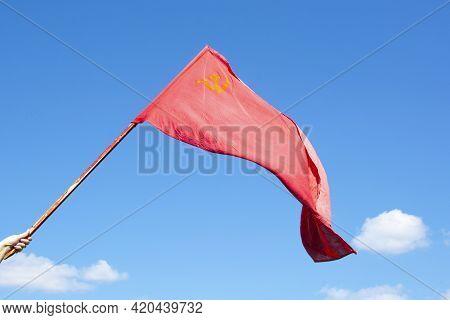 The Union Of Soviet Socialist Republics Flag Waving On Blue Background