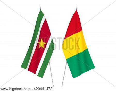 National Fabric Flags Of Guinea And Suriname Isolated On White Background. 3d Rendering Illustration