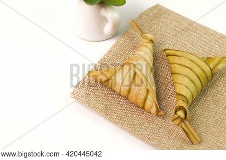 Ketupat Palas Or Dumpling Rice On Gunny Sack. Ketupat Palas Is A Natural Rice Casing Made From Young