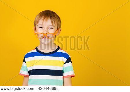 Smart Boy Kid Wearing Glasses. Little Nerd In Eyewear Having Fun At Studio. Face Emotion And Express