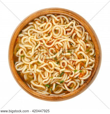 Instant Ramen With Vegetable Taste In A Wooden Bowl. Instant Noodles, Soaked In Boiling Water And Se