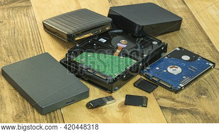 Pile Of Hdd Memory Storage Devices Over Dark Surface, Tech Components, Usb, Memory
