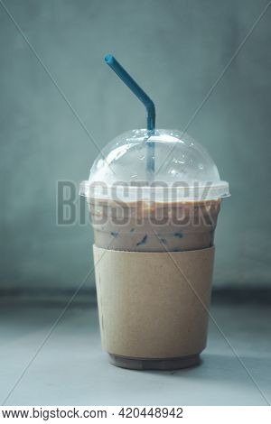 Iced Coffee Mocha In Cups With Brown Paper Sleeve On Table In The Shop. Relax Time