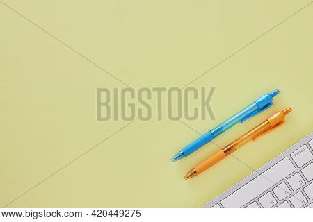 Top View Or Flat Lay Modern Office Desk Or Office Table With Computer Keyboard And Blue And Orange P