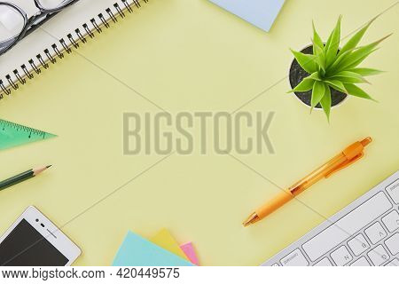 Top View Or Flat Lay Modern Office Desk Or Office Table With Stationery As Keyboard,pen,stick Note,m