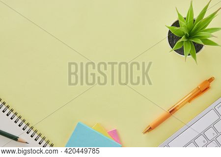 Top View Or Flat Lay Modern Office Desk Or Office Table With Office Supplies As Keyboard,pen,stick N