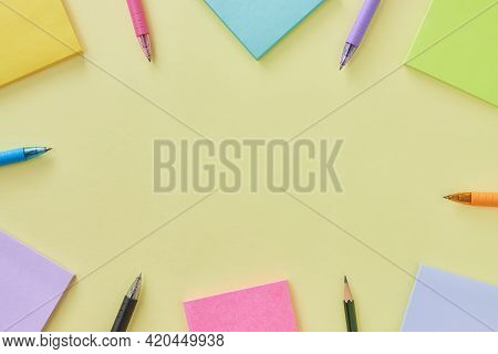 Top View Or Flat Lay Stick Note And Pen On Office Desk Or Office Table Background. Office Supplies O