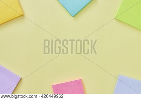 Top View Or Flat Lay Yellow Office Desk Or Office Table Background And Stick Note. Office Supplies O