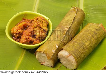 Malaysian Traditional Food Called As Lemang And Chicken Rendang. Glutinous Rice Is Wrapped With Lere