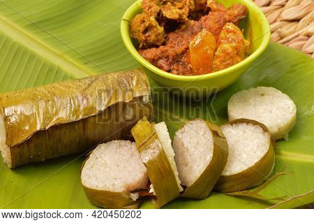 Malaysian Traditional Food Called As Lemang And Chicken Rendang. Glutinous Rice Is Wrapped With Bana