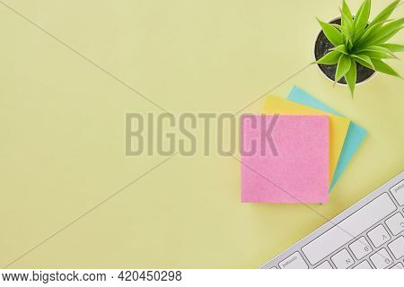 Top View 3 Stick Note And Keyboard And Office Plants On Office Desk Or Office Table Background. Offi