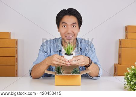 Online Merchant Or Casual Businessman In Online Store Show Office Plant Product On Center Frame