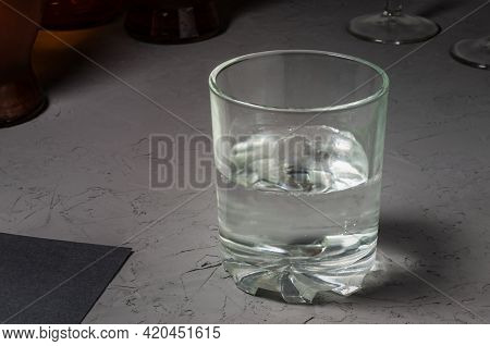 The Glass Is Half Full Of Water. High Quality Photo