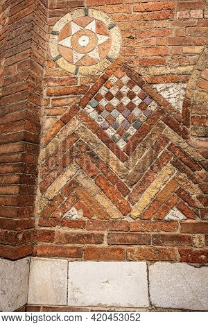 Closeup Of The Ancient Brick Wall Of The Basilica Of Santo Stefano Also Called The Seven Churches In