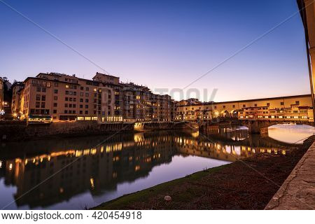 Medieval Ponte Vecchio (old Bridge) And The River Arno, Florence Downtown, Unesco World Heritage Sit