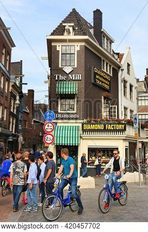 Amsterdam, Netherlands - July 7, 2017: People Walk By Diamond Factory Jewelry Shop In Amsterdam, Net