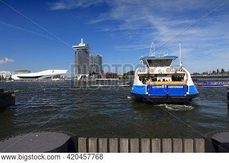 Amsterdam, Netherlands - July 9, 2017: People Ride The Ferry To Cross Ij Bay In Amsterdam, Netherlan