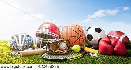 Various Sport Equipment And Balls On Grass