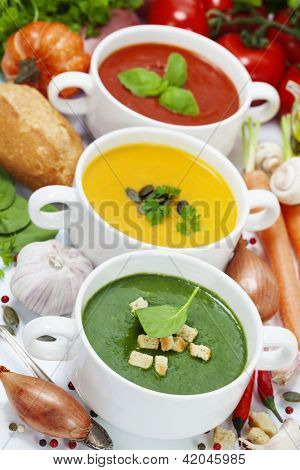 Three traditional soups (tomato, pumpkin and  spinach). Traffic light concept