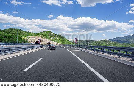 Makarska, Croatia - July 16, 2017: Cars Speeding On The Autobahn Among Mountain Scenery.