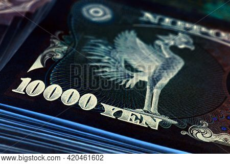 A Bundle Of 10,000 Yen Japanese Bills. The Reverse Of The Banknote With The Phoenix Bird Close-up. I