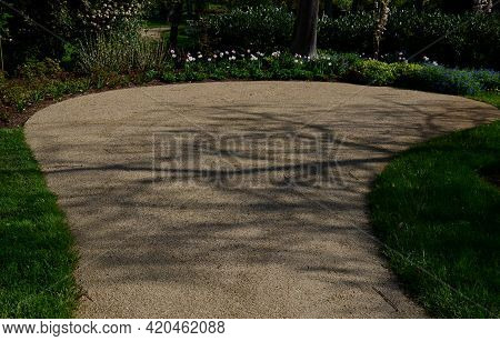Beautiful Nook In The Spa Park With Light Paths And Flowering Shrubs Perennials And Bulbs In A Color