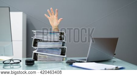 Corporate Desk Document Overload. Stacked Pile Of Paperwork