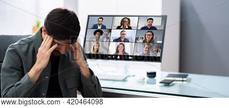 Bored Employee With Head Ache And Stress In Video Conference Call