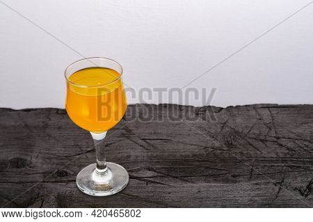 Orange Juice In A Glass On A Black Background. Horizontal Photo