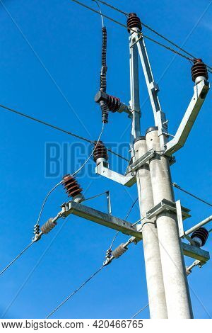 High-voltage Electrical Insulator Electric Line Against The Blue Sky. Energy Electricity Power Pylon