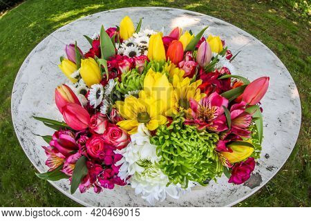 Flowers bouquet outdoor on white table