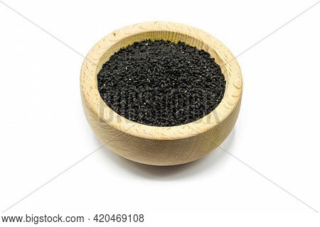 Real Black Cumin In Wooden Bowl Isolated On White Background