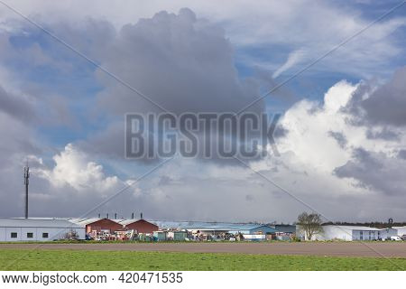 Dutch Industrial Park Near Emmeloord With Stormy Clouds Sky