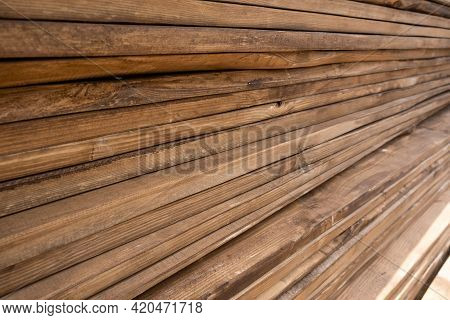 Piles Of Wooden Planks At A Sawmill, Formwork. Warehouse For Sawing Boards At An Outdoor Sawmill. Pl