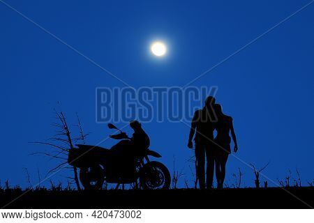 A Couple And Bike Under The Moon In The Dense Dark Night
