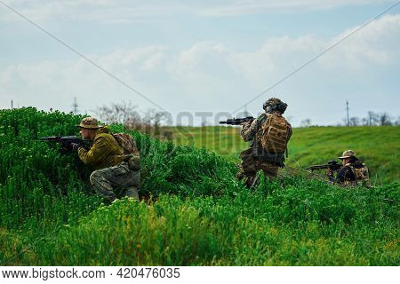 Airsoft Players Hiding Behind A Hill Are Fighting