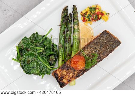 Overhead View Of Grilled Salmon Steak Served With Asparagus And Spinach To Indulge That Seafood Appe